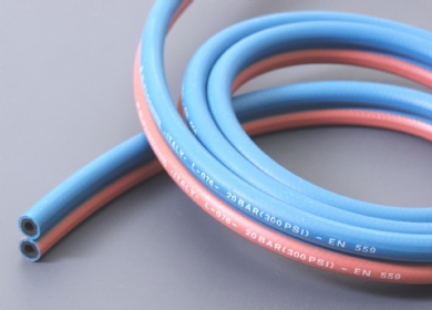 Click to enlarge - Twin line (Siamese) oxygen-acetylene hoses bonded together for safe workshop practice. Used for welding and cutting applications.